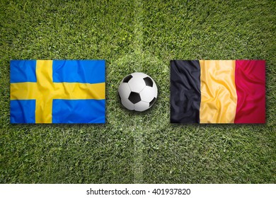 Sweden vs. Belgium flags on green soccer field