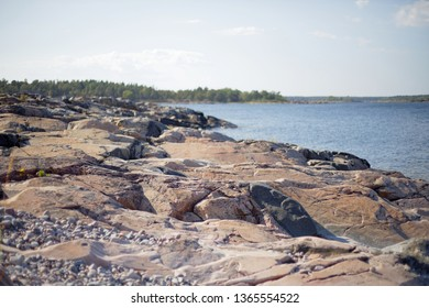 Swedish archipelago during summer. Cliffs, pebbles and distant islands