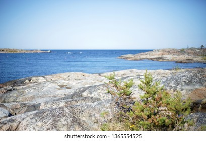 Swedish archipelago during summer. Cliffs, sea and distant islands