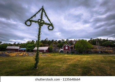Swedish Archipelago - June 23, 2018: Midsummer pole in the island of Moja in the Swedish Archipelago during Midsummer, Sweden