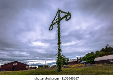 Swedish Archipelago - June 23, 2018: Midsummer pole in the island of Moja in the Swedish Archipelago during Midsummer, Sweden