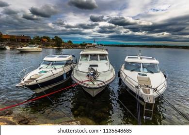 Swedish Archipelago - June 23, 2018: Boats in the harbor in the island of Moja in the Swedish Archipelago during Midsummer, Sweden