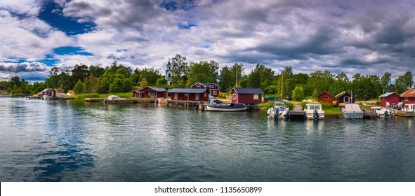 Swedish Archipelago - June 23, 2018: Panoramic view of a small coastal town in the island of Moja in the Swedish Archipelago during Midsummer, Sweden