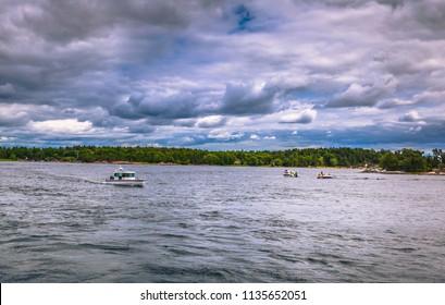 Swedish Archipelago - June 23, 2018: Small boats in the Swedish Archipelago during Midsummer, Sweden