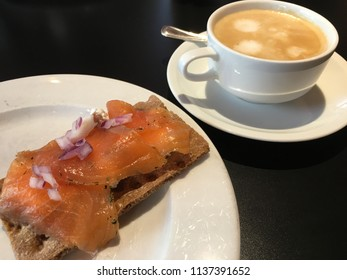 Swedish breakfast: Smoked salmon on crackerbread with a coffee
