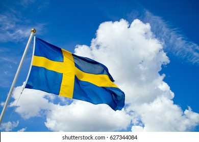 Swedish flag on blue summer sky