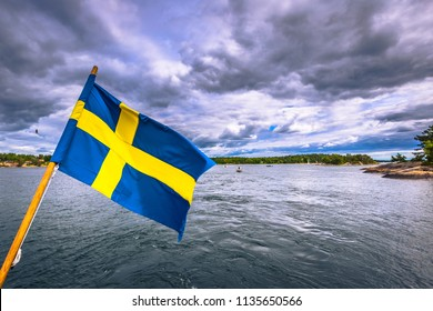 Swedish flag on a ferry in the Swedish Archipelago during Midsummer, Sweden