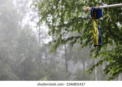 The swedish flag on a rainy summer day.