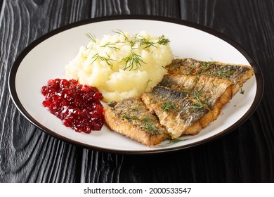 Swedish food Fried herring Stekt Stromming with Potato Puree closeup in the plate on the table. Horizontal - Shutterstock ID 2000533547