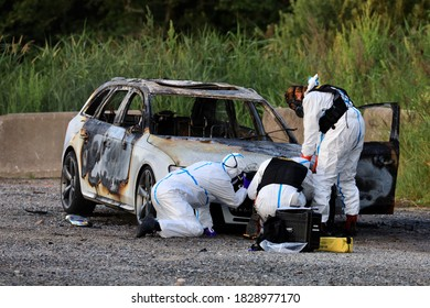 Swedish forensic scientists investigate the burned-out car that is believed to be connected to a shooting in which a 12-year-old girl died.