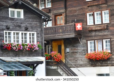 Swedish Houses with Floral Hanging Baskets