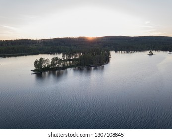 Swedish islands in a lake in the light of a sunset