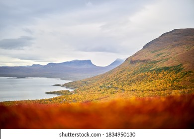 Swedish Lapland view with Torneträsk lake, nuolja mountain and Lapporten valley, all seen from Björkliden montains top.