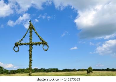 A swedish midsummer pole at blue sky, typical for celebrating midsummer in Sweden