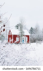 Swedish red house, cottage on a white winter morning, snow