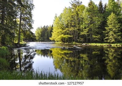 Swedish river and natural salmon area in spring. Farnebofjarden national park