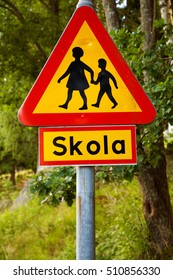 Swedish road sign beware of children, with the sign, which clarifies that there is a school (skola) nearby. - Shutterstock ID 510856330