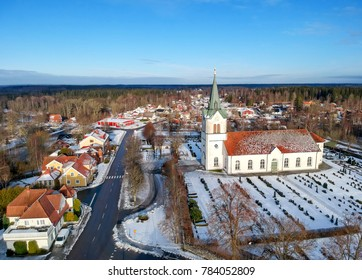Swedish small village in vinter - view with main street and church