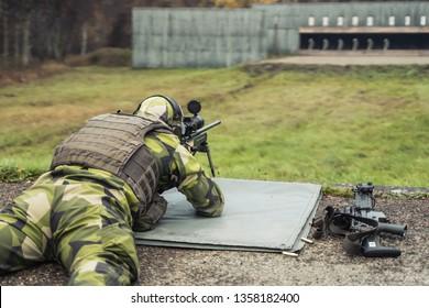 Swedish soldier firing a  sniper rifle at a shooting range