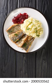 Swedish Stekt stromming or fried herring with boiled potatoes and lingonberry jam closeup in the plate on the table. Vertical top view from above - Shutterstock ID 2000533562