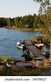 Swedish summer place , red house , boats in the lake