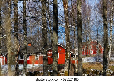 swedish traditional red countryside house. housing by woods. village in southern sweden province smaland.