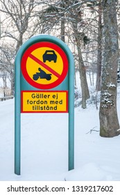 "A Swedish traffic sign agains motor vehicles beyond this point. Text below says ""not for those with permission""."