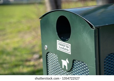 """Swedish trash can for dog feces to be used by dog owners. Text """"Endast för hundlatrin"""" means """"only for dog feces""""."""