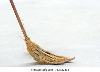 Sweep debris with a broom
