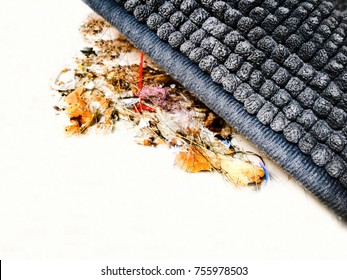 Sweep under the carpet.Image of someone hide dirt by brushing it away under the edge of a carpet.The concept of to hide or ignore something.