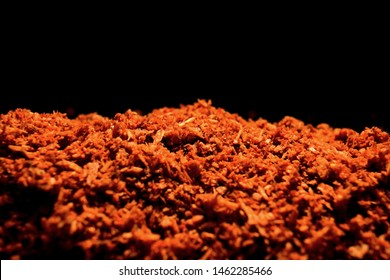 Sweeping compound - red colored dust.