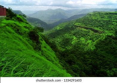 Sweeping landscape of the Khandala plateau (Western ghats mountain range) in its full greenish environments taken on the Mumbai Pune highway at Lonavla, Maharashtra,India