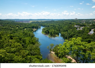 Sweeping landscape vista of Table Rock Lake and surrounding scenery in Branson Missouri on a beautiful sunny blue sky afternoon.