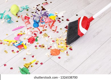 Sweeping trash after party with bristle broom indoors