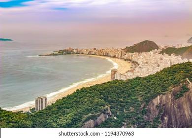 Sweeping View of beautiful Copacabana beach and buildings in the  city of  Rio de Janeiro , Brazil , South America