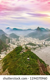 Sweeping View of buildings in the  city of  Rio de Janeiro with Favelas in the hills with misty hills and statue on mountain, Brazil , South America