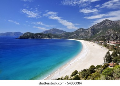 Sweeping white beach with blue sky and sea