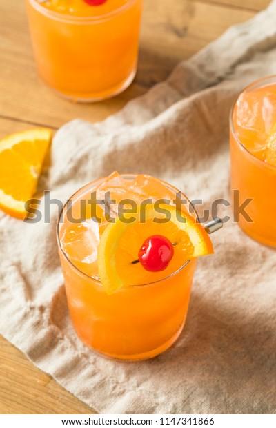 Sweet Alcoholic Rum Swizzle with Orange and PIneapple
