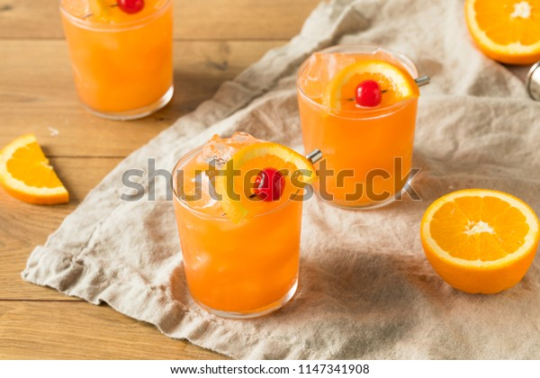 Sweet Alcoholic Rum Swizzle with Orange and PIneapple