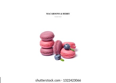 Sweet almond colorful pink, lilac macaron or macaroon dessert, cake with berry on isolated white background. Minimum bakery concept. French sweet biscuits. Place for text. The view from the top