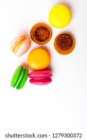 Sweet almond colorful pink, yellow, green, brown macaron or macaroon dessert cake isolated on white background. French sweet cookie. Minimal food bakery concept. top view, copy space
