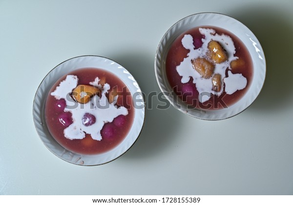 Sweet appetizers and banana with brown thick sweet brown sauce and coconut milk, its famous Indonesian food, known as KOLAK for break fasting during Ramadan month