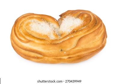 Sweet appetizing bun with sugar in form heart isolated on white background