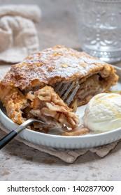 Sweet apple strudel with vanilla ice cream