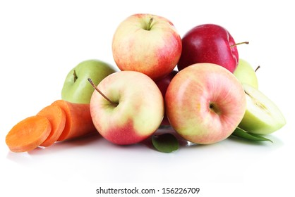 Sweet apples and carrot isolated on white
