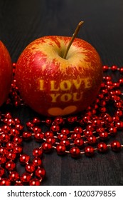 sweet apples writining i love you with red beads