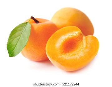 Sweet apricots with leafs isolated on white