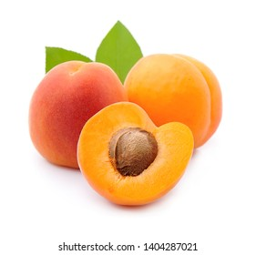 Sweet apricots with leaves isolated on white backgrounds.