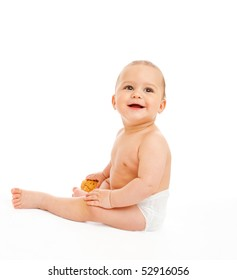Sweet baby in diaper holding bun in hand
