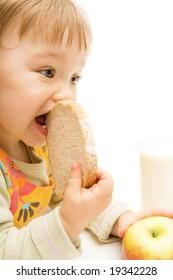 sweet baby girl eating bread